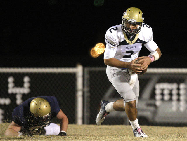 Former Heritage Hall quarterback Quinn Shanbour, shown here during a 2011 game, will walk on to the Oklahoma State football team. PHOTO BY SARAH PHIPPS, Oklahoman Arcives <strong>SARAH PHIPPS</strong>