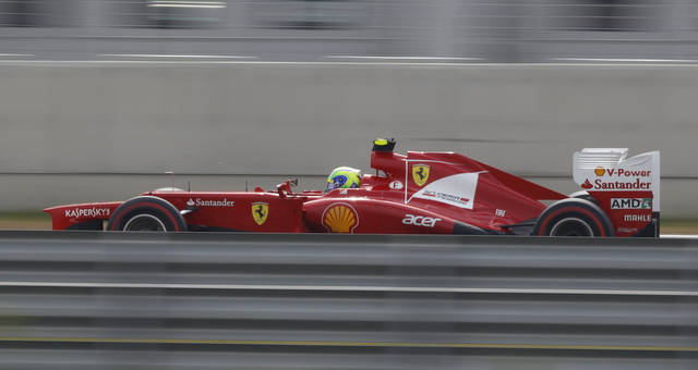 Ferrari driver Felipe Massa of Brazil steers his car during the third practice session for the Korean Formula One Grand Prix at the Korean International Circuit in Yeongam, South Korea, Saturday, Oct. 13, 2012. (AP Photo/Dita Alangkara)