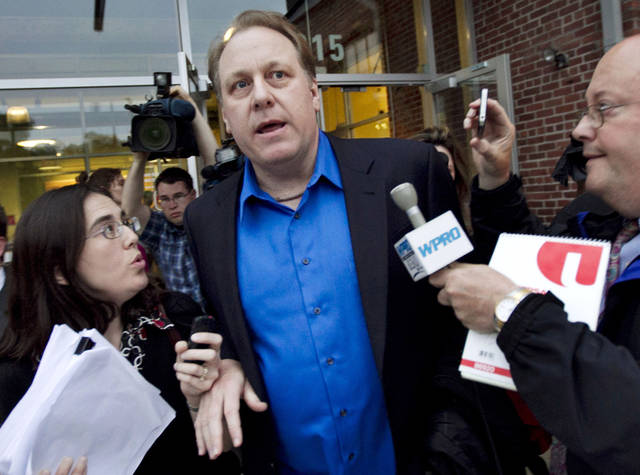 FILE - In this May 21, 2012 file photo, former Boston Red Sox pitcher Curt Schilling, center, departs the Rhode Island Economic Development Corporation headquarters in Providence, R.I., after he met with the agency to discuss the finances of his troubled video company. The government deal that guaranteed a $75 million loan for Schilling's 36 Studios focused almost exclusively on how quickly the firm would bring jobs to Rhode Island and overlooked requirements for attracting outside investment or other steps that could have helped protect the public's money. (AP Photo/Steven Senne, File)