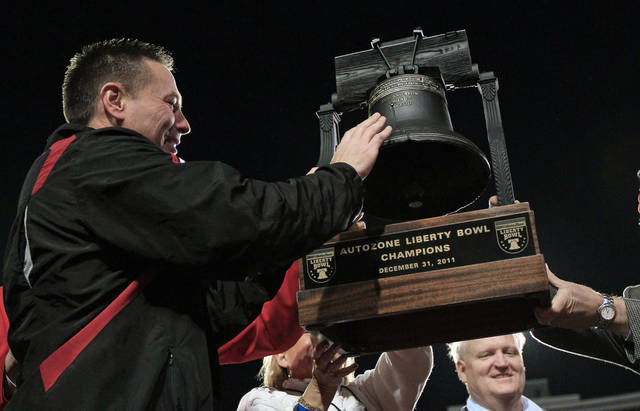 Cincinnati head coach Butch Jones, left, is presented the trophy after defeating Vanderbilt 31-24 in the Liberty Bowl NCAA college football game on Saturday, Dec. 31, 2011, in Memphis, Tenn. (AP Photo/Mark Humphrey)