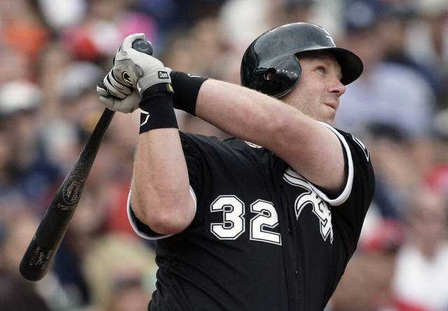Chicago White Sox's Adam Dunn watches his two-run home run in the ninth inning of a baseball game to defeat the Detroit Tigers 3-2, Saturday, May 5, 2012, in Detroit. (AP Photo/Duane Burleson)