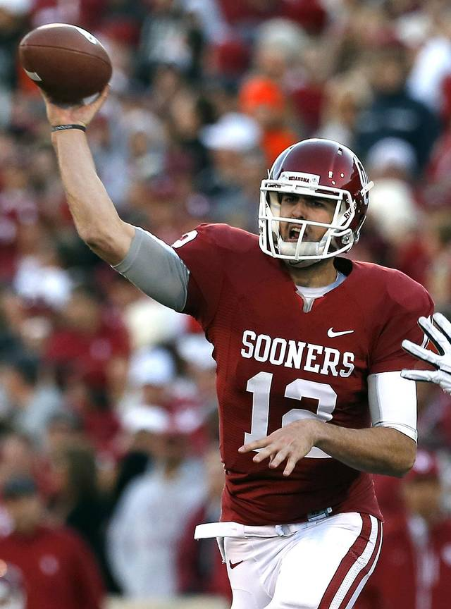 Oklahoma's Landry Jones (12) throws a pass during the Bedlam college football game between the University of Oklahoma Sooners (OU) and the Oklahoma State University Cowboys (OSU) at Gaylord Family-Oklahoma Memorial Stadium in Norman, Okla., Saturday, Nov. 24, 2012. OU won 51-48 in overtime. Photo by Sarah Phipps, The Oklahoman