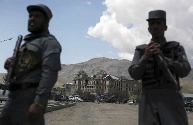 Afghan policemen stand guard near the site of a suicide attack in Kabul,  Afghanistan, Tuesday, May 18, 2010. A suicide car bomber attacked the heavily fortified Afghan capital early Tuesday, killing at least 12 people including five foreigners, officials said. (AP Photo)