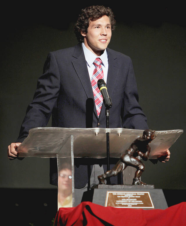 Oklahoma quarterback Sam Bradford speaks during a ceremony to honor him at Putnam City North on Friday. Photo by Bryan Terry, The Oklahoman
