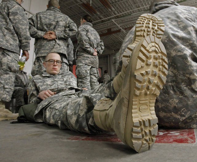 Fort Sill soldier Morgan Lutz, Wichita, Kans., and others wait for transportation home for the holidays at the YMCA Military Welcome Center at Will Rogers World Airport on Saturday, Dec. 17, 2011, in Oklahoma City, Okla.   Photo by Steve Sisney, The Oklahoman