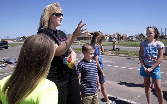 Gina Janzen, a second grade teacher at Briarwood Elementary, stands in the school's parking lot on Monday, June 10, 2013 with students and recalls what happened the day of the May 20th tornado. Photo by Aliki Dyer, The Oklahoman