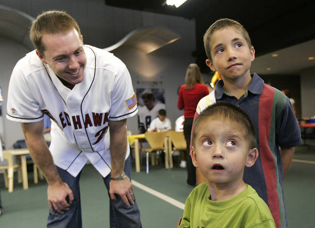 Chris Richard (27), left, talks to Tyler Bandy, 2, front, and his brother Ryan Bandy, 8, both of Marlow, Okla., during the Oklahoma RedHawks visit with children and their families at The Children's Hospital at OU Medical Center in Oklahoma City, June 14, 2005. By Nate Billings/The Oklahoman