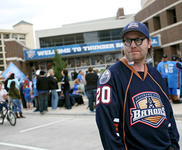 "Shawn Davis, known as ""Eye Guy"" to Oklahoma City Barons fans, joins Thunder fans on Reno Ave before the first round NBA Playoff basketball game between the Thunder and the Nuggets at OKC Arena in downtown Oklahoma City on Wednesday, April 20, 2011. Photo by John Clanton, The Oklahoman"