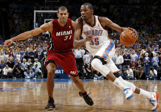 Oklahoma City�s Kevin Durant, right, drives the ball past Miami�s Shane Battier at Chesapeake Energy Arena on Sunday. Battier said Sunday following the Thunder�s 103-87 victory that signing with the Thunder last offseason �was a very intriguing possibility for me.�Photo by Nate Billings, The Oklahoman