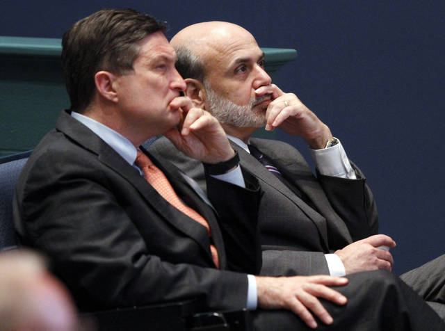 FILE - In this June 9, 2010, file photo, Federal Reserve Chairman, Ben Bernanke, right, listens with president of the Federal Reserve of Richmond, Jeffrey Lacker, left, at J. Sergeant Reynolds Community College in Richmond, Va.  With an eye on the �fiscal cliff,� the Federal Reserve is expected to announce a new bond-buying plan to support the U.S. economy on Tuesday, Dec. 11, 2012. Lacker has said he thinks the job market is being slowed by factors beyond the Fed's control and he says further bond purchases risk worsening future inflation. (AP Photo/Steve Helber, File)