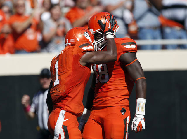 Oklahoma State's Joseph Randle (1) celebrates with Oklahoma State's Blake Jackson (18) after his 62-yard rush in the fourth quarter during a college football game between Oklahoma State University (OSU) and Iowa State University (ISU) at Boone Pickens Stadium in Stillwater, Okla., Saturday, Oct. 20, 2012. Photo by Sarah Phipps, The Oklahoman
