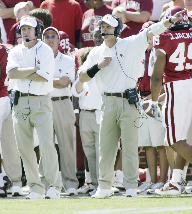 OU vs UCLA college football in Norman, Okla. at The Gaylord Family - Oklahoma Memorial Stadium Spet. 20, 2003. University of Oklahoma's co-defensive coordinators Mike Stoops, left, and Brent Venables call the action from the sideline. For Rhode story. Staff photo by Doug Hoke.