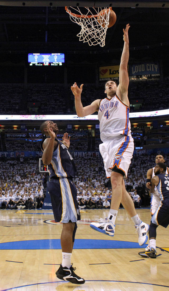 Oklahoma City's Nick Collison (4) goes to the basket beside Darrell Arthur (00) of Memphis during game five of the Western Conference semifinals between the Memphis Grizzlies and the Oklahoma City Thunder in the NBA basketball playoffs at Oklahoma City Arena in Oklahoma City, Wednesday, May 11, 2011. Photo by Bryan Terry, The Oklahoman
