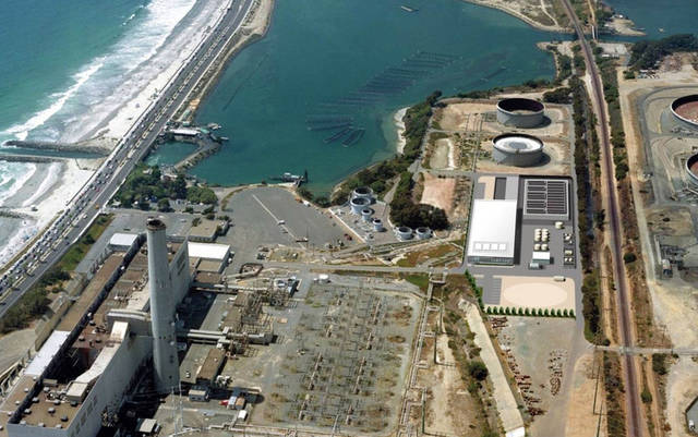 This image provided by the San Diego County Water Authority shows an artist rendering of a proposed desalination plant, center right, superimposed over an aerial photograph, in Carlsbad, Calif.  The proposed plant will be the Western Hemisphere�s largest desalination plant. (AP Photo/San Diego County Water Authority)