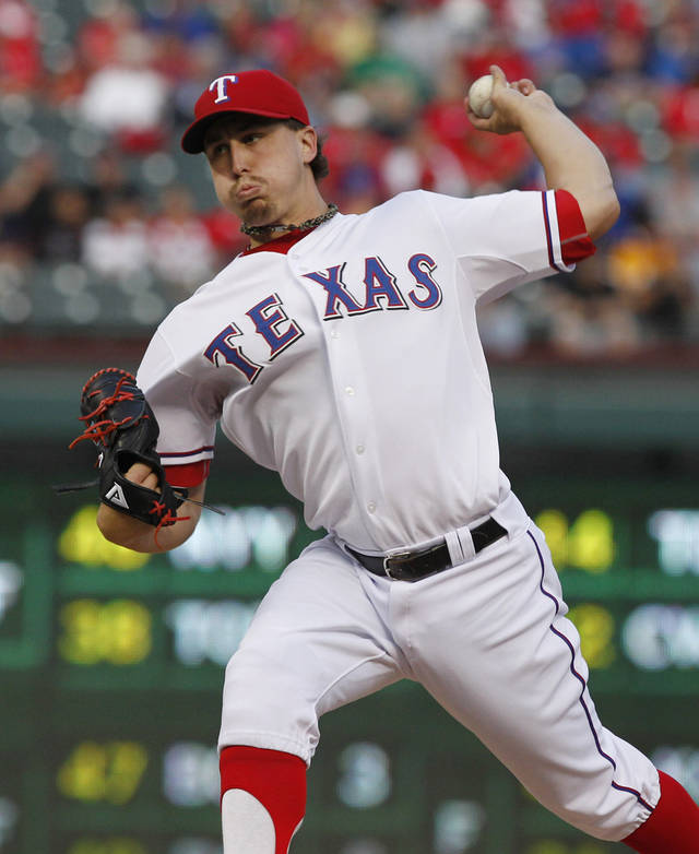 Texas Rangers starting pitcher Derek Holland throws during the first inning of the second baseball game of a doubleheader against the Los Angeles Angels, Sunday, Sept. 30, 2012, in Arlington, Texas. (AP Photo/LM Otero)