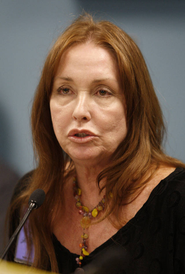 FILE - In this Sept. 2, 2009 pool file photo, Debra Tate, sister of slain Sharon Tate, speaks during a parole hearing for Manson follower Susan Atkins at the Central California Women's Facility in Chowchilla, Calif. On Aug. 9, 1969, two naive 17-year-olds were launched on a path toward the most unlikely of friendships. That infamous night four young people under the sway of a charismatic career criminal slipped into a home in a neighborhood of Hollywood glitterati, then bludgeoned and stabbed rising young actress Sharon Tate, her friend and coffee heiress Abigail Folger, and two others. (AP Photo/Ben Margot, Pool, File)