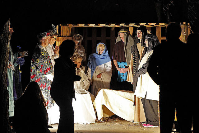 Top: People visit a living nativity scene Dec. 16 at New Covenant Christian Church in Oklahoma City.