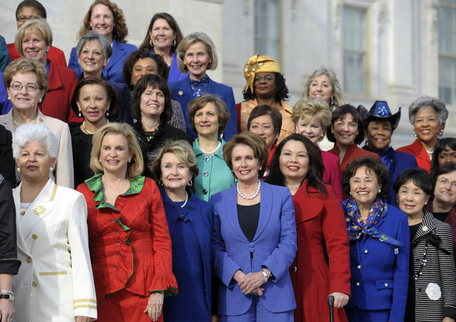 House Minority Leader Nancy Pelosi of Calif., front row, center, poses with other female House members on the steps of the House on Capitol Hill in Washington, Thursday, Jan. 3, 2013, prior to the official opening of the 113th Congress . (AP Photo/Cliff Owen)