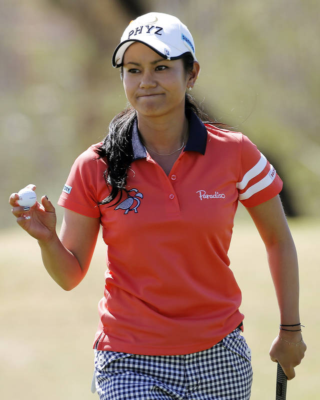 Ai Miyazato, of Japan, acknowledges the gallery on the third green during the third round of the Founders Cup golf tournament, Saturday, March 16, 2013, in Phoenix. (AP Photo/Matt York)