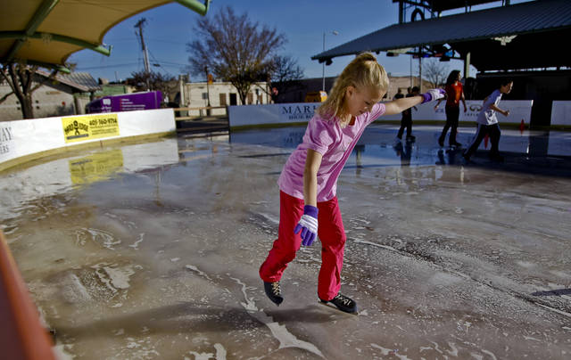 Anna Gregory works to get her balance while on the ice at the Edmond outdoor ice skating rink on Sunday, Dec. 2, 2012, in Edmond, Okla.   Photo by Chris Landsberger, The Oklahoman