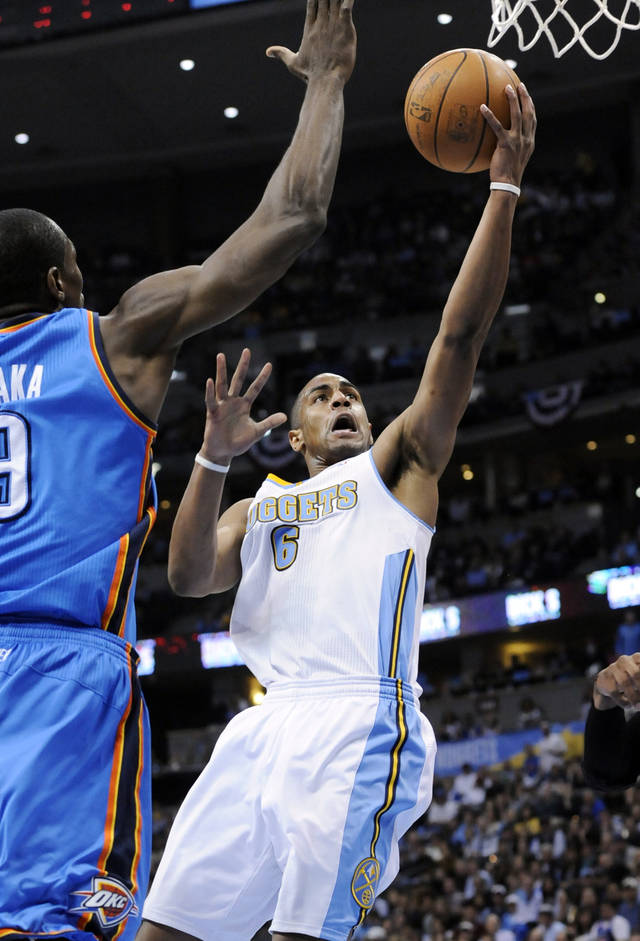 Denver Nuggets guard Arron Afflalo (6) goes up for a shot against Oklahoma City Thunder forward Serge Ibaka (9) from the Republic of Congo during the second half in game 4 of a first-round NBA basketball playoff series Monday, April 25, 2011, in Denver. (AP Photo/Jack Dempsey)