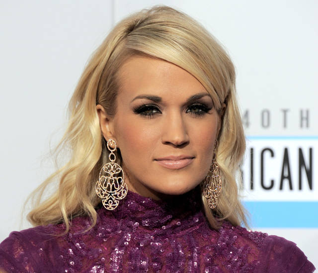 FILE - In this Sunday, Nov. 18, 2012 file photo, Carrie Underwood arrives at the 40th Anniversary American Music Awards in Los Angeles. Underwood will star in NBC's live broadcast of �The Sound of Music� late next year, according to a news release Friday, Nov. 30, 2012. (Photo by Jordan Strauss/Invision/AP, File)