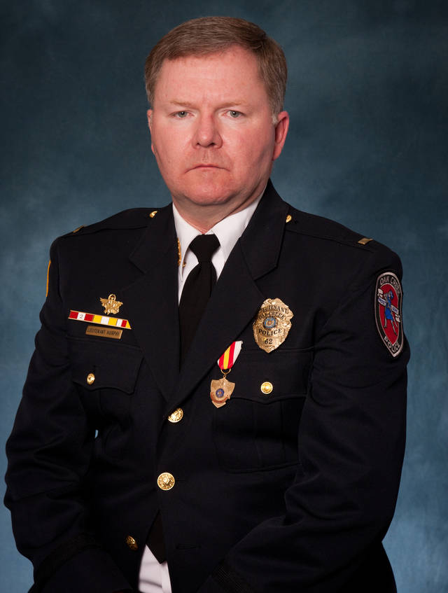 "This undated picture provided by the Oak Creek Police Department shows Lt. Brian Murphy. Murphy, 51, is a 21-year veteran with the Oak Creek Police Department. Police Chief John Edwards said the gunman in the Sikh temple shooting ""ambushed"" Murphy, one of the first officers to arrive at the temple as the officer tended to a victim outside, shooting him eight to nine times with a handgun at close range. A second officer then exchanged gunfire with the gunman, who was fatally shot. Murphy was in critical condition along with two other victims Monday, authorities said. (AP Photo/Oak Creek Police Department)"