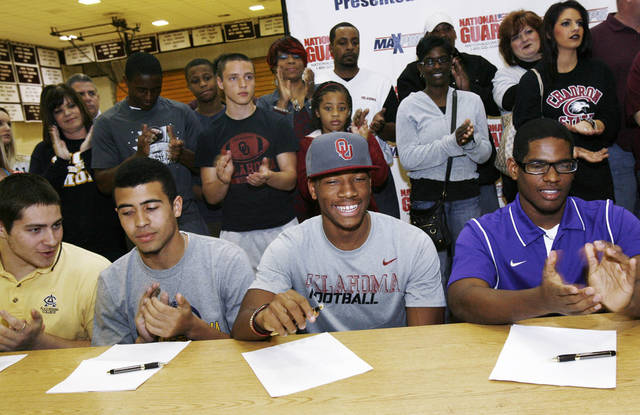 Members of the Jenks high school football team including Nick Lucido (left), Taylor Hunter, Jordan Smallwood, and Jeff Scallion, taken during signing Day in Jenks, Okla., on February 6,2013. JAMES GIBBARD/Tulsa World