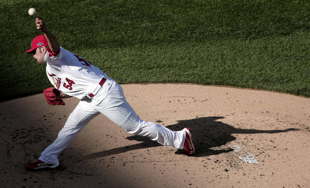 CORRECTS IDENTITY TO JAIME GARCIA, NOT CHRISTIAN GARCIA- St. Louis Cardinals starting pitcher Jaime Garcia throws during the first inning of Game 2 of the National League division baseball series against the Washington Nationals, Monday, Oct. 8, 2012, in St. Louis. (AP Photo/Charlie Riedel)