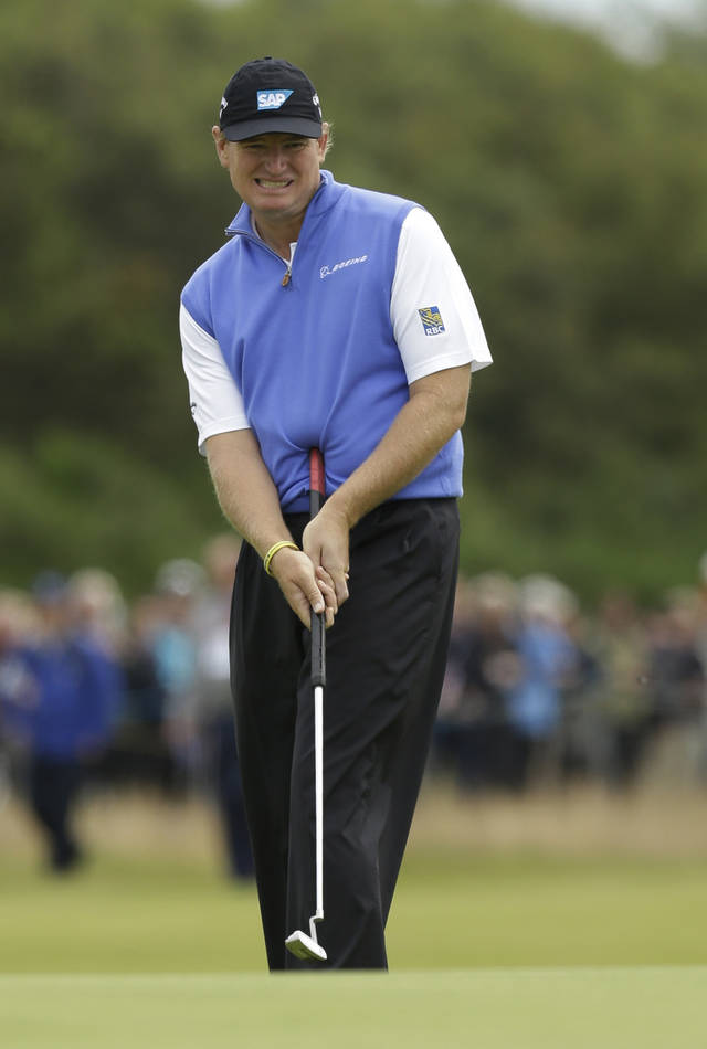 "FILE - This July 19, 2012 file photo shows Ernie Els of South Africa reacting to a putt on the 11th green at Royal Lytham & St Annes golf club during the first round of the British Open Golf Championship in Lytham St Annes, England. Els is ready to ""play ball"" even without a long putter. The four-time major champion, who won last year's British Open with a belly putter, said Wednesday, May 22, 2013 that the PGA Tour should accept the decision by golf's ruling bodies to ban anchoring and long-handled putters in 2016. (AP Photo/Jon Super, File)"