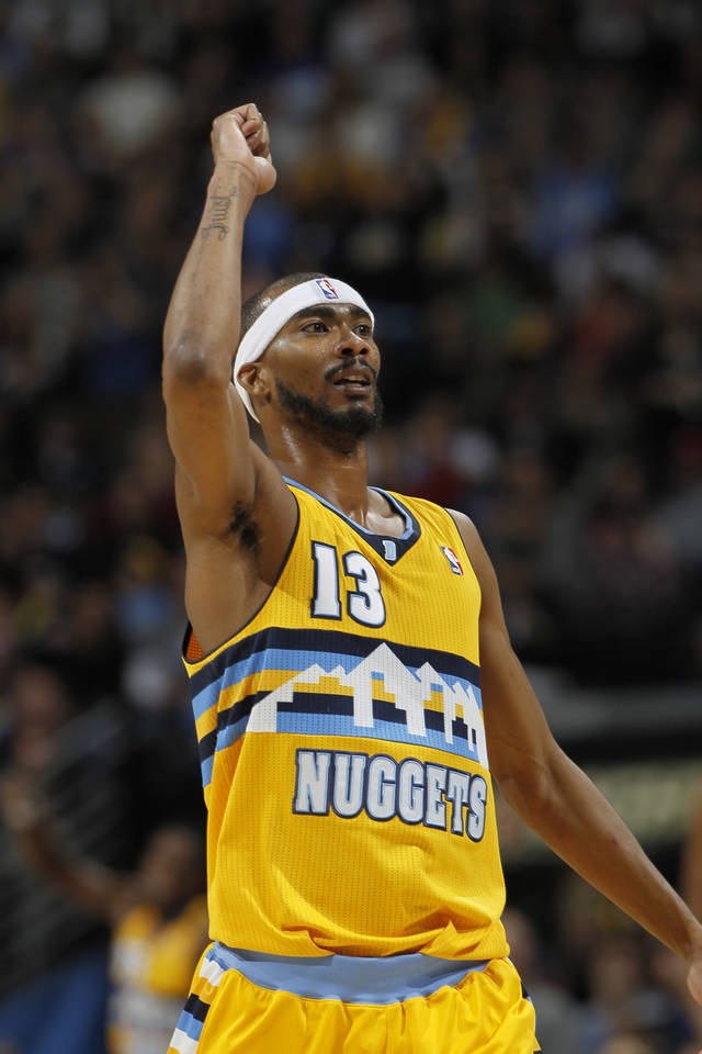 Denver Nuggets guard Corey Brewer reacts after hitting a basket against the Oklahoma City Thunder in the fourth quarter of an NBA basketball game in Denver on Sunday, Jan. 20, 2013. The Nuggets won 121-118 in overtime. (AP Photo/David Zalubowski)