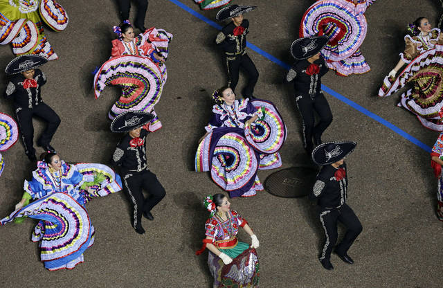Palmview High School Mariachi and Folkloric Group, Texas, dance down Pennsylvania Avenue en route to the White House, Monday, Jan. 21, 2013, in Washington. Thousands  marched during the 57th Presidential Inauguration parade after the ceremonial swearing-in of President Barack Obama. (AP Photo/Charlie Neibergall ) ORG XMIT: DCMS172