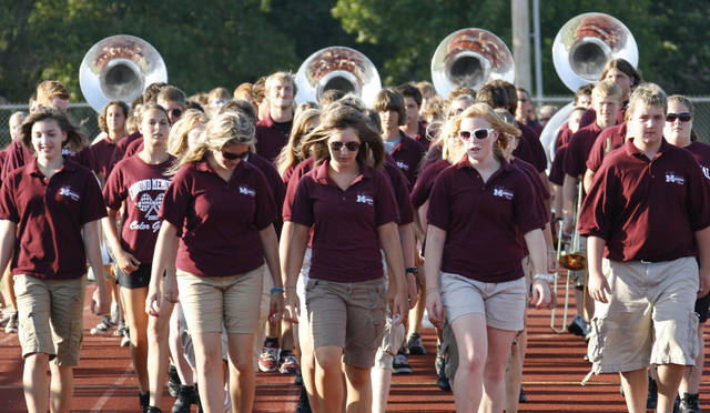 The band comes onto the field at the back to school Memorial High School Bulldog Bash Saturday, Aug. 11, 2007. BY DOUG HOKE, THE OKLAHOMAN