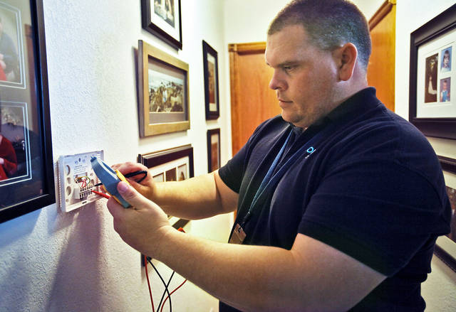OG&E's Greg Henderson installs and programs the new smart meter system in a home on Thursday, Jan. 19, 2012, in Piedmont, Okla. Photo by Chris Landsberger, The Oklahoman
