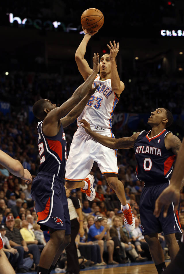 Oklahoma City Thunder's Kevin Martin (23) shoots defended by Atlanta Hawk's Anthony Morrow (22) and Jeff Teague (0) as the Oklahoma City Thunder play the Atlanta Hawks in NBA basketball at the Chesapeake Energy Arena in Oklahoma City, on Sunday, Nov. 4, 2012.  Photo by Steve Sisney, The Oklahoman