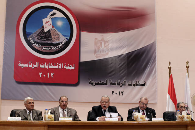 The Egyptian special election committee announces the result in the Egyptian presidential election, at a press conference in Cairo, Egypt, Monday, May 28, 2012. From left: judge Mohamed Mommtaz, judge Abd el-Moez Ebrahim, judge and chairman Farouk Sultan, judge Maher Behery and judge Ahmed Kafagy. The chairman of Egypt's presidential election commission says the Muslim Brotherhood's candidate and Hosni Mubarak's last prime minister will context next month's runoff vote. Farouq Sultan said Monday the official final results show the Brotherhood's Mohammed Morsi and Ahmed Shafiq, a former air force commander, as the top two finishers in the first round of voting on May 23-24. He said Morsi won 5.76 million votes, while Shafiq garnered 5.5 million votes. (AP Photo/Frederik Persson)