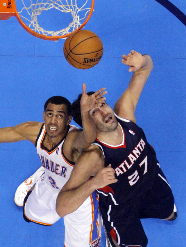 Oklahoma City Thunder&#039;s Thabo Sefolosha (2) and Atlanta Hawk&#039;s Zaza Pachulia (27) fight for a rebound as the Atlanta Hawks defeat the Oklahoma City Thunder 104-95 in NBA basketball at the Chesapeake Energy Arena in Oklahoma City, on Sunday, Nov. 4, 2012.  Photo by Steve Sisney, The Oklahoman
