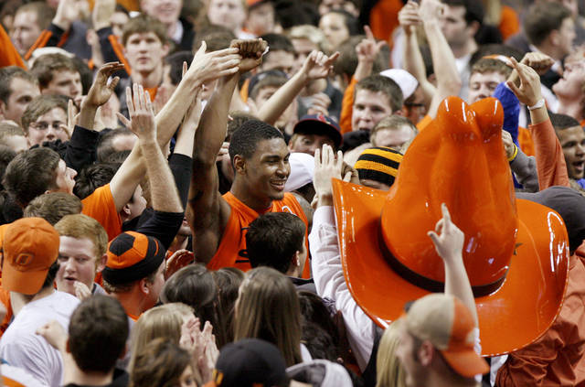 Oklahoma State&#039;s Le&#039;Bryan Nash celebrates with fans following an NCAA college basketball game between the Oklahoma State University Cowboys (OSU) and the Missouri Tigers (MU) at Gallagher-Iba Arena in Stillwater, Okla., Wednesday, Jan. 25, 2012. Oklahoma State won 79-72. Photo by Bryan Terry, The Oklahoman