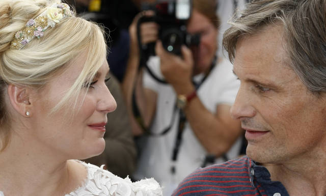Actors Kirsten Dunst, left and Viggo Mortensen pose during a photo call for On the Road at the 65th international film festival, in Cannes, southern France, Wednesday, May 23, 2012. (AP Photo/Lionel Cironneau)
