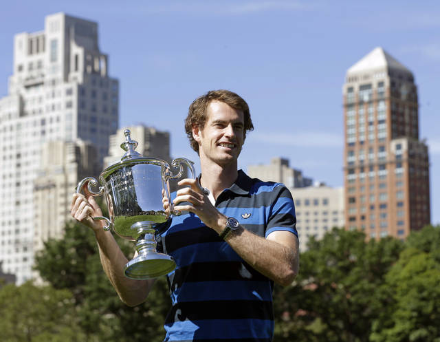 2012 U.S. Open tennis men's singles champion Andy Murray, of Britain, poses in Central Park on Tuesday, Sept. 11, 2012, in New York. (AP Photo/Mike Groll)