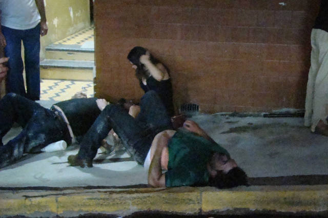 Injured people lies on the ground outside the Kiss nightclub in Santa Maria city,  Rio Grande do Sul state, Brazil, Sunday, Jan. 27, 2013.  A blaze raced through the crowded nightclub in southern Brazil early Sunday, killing more than 200 people as the air filled with deadly smoke and panicked party-goers stampeded toward the exits, police and witnesses said. It appeared to be the world's deadliest nightclub fire in more than a decade.(AP Photo/Roger Shlossmacker)