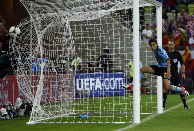 Spain's Jesus Navas scores the only goal during the Euro 2012 soccer championship Group C match between Croatia and Spain in Gdansk, Poland, Monday, June 18, 2012. (AP Photo/Darko Bandic)