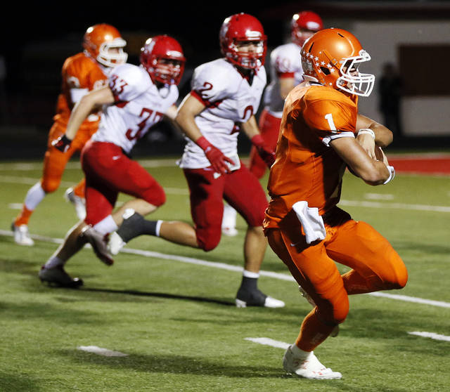 Celina quarterback Nathan Elliott (1) carries the ball on his way to a touchdown during a high school football game between Texas&#039;s Celina Bobcats and Perryton Rangers in the old football stadium at Yukon Middle School in Yukon, Okla., Friday, Sept. 28, 2012. Photo by Nate Billings, The Oklahoman