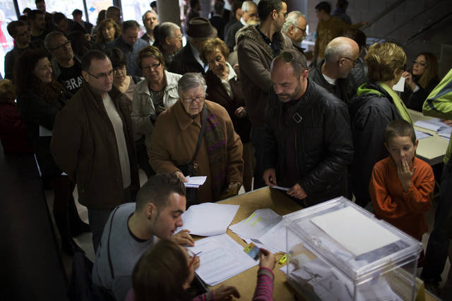   Voters wait to cast their ballots in a polling station in Barcelona, Spain, on Sunday, Nov. 25, 2012. Voters in Catalonia begin casting their ballots in regional elections that could determine the future shape of Spain. If voters give the regional government strong support, its leader pledged to hold a referendum asking Catalans if they&#039;d prefer to split from Spain and go it alone in the 27-member EU. (AP Photo/Emilio Morenatti)  