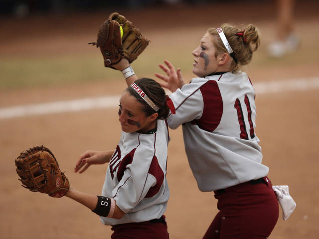 Tuttle's Shea Coats (11) catches a ball during the 4A state softball semifinals game between Oolagah-Talala and Tuttle at ASA Hall of Fame Stadium in Oklahoma City, Okla., Friday, Oct. 12, 2012.  Photo by Garett Fisbeck, The Oklahoman