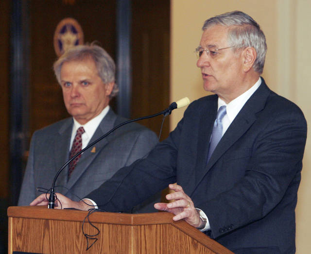 Oklahoma State Representative Richard Morrissette (left) and DHS director Howard Hendricks speak to meeting participants during a public hearing on the Department of Human Services at the Oklahoma state Capitol in Oklahoma City, OK, Tuesday, April 8, 2008. BY PAUL HELLSTERN, THE OKLAHOMAN