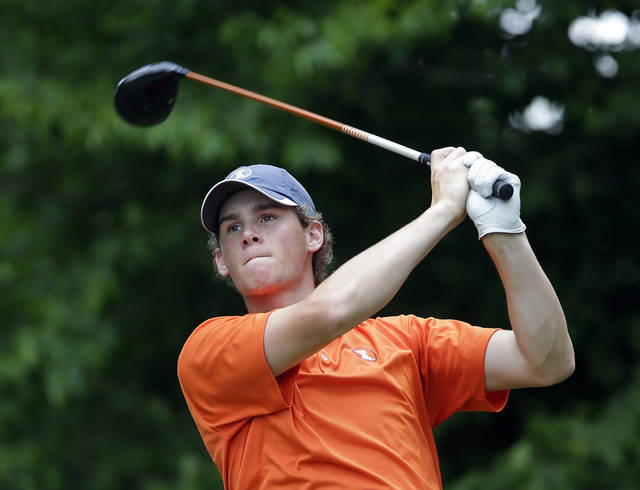 Illinois' Thomas Detry hits from the tee on the 12th hole during the final round of play in the NCAA college men's golf championship against Alabama,  Sunday, June 2, 2013, in Milton, Ga. (AP Photo/John Bazemore)