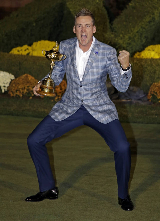 Europe's Ian Poulter celebrates with the trophy after winning the Ryder Cup PGA golf tournament Sunday, Sept. 30, 2012, at the Medinah Country Club in Medinah, Ill. (AP Photo/Chris Carlson)  ORG XMIT: PGA269