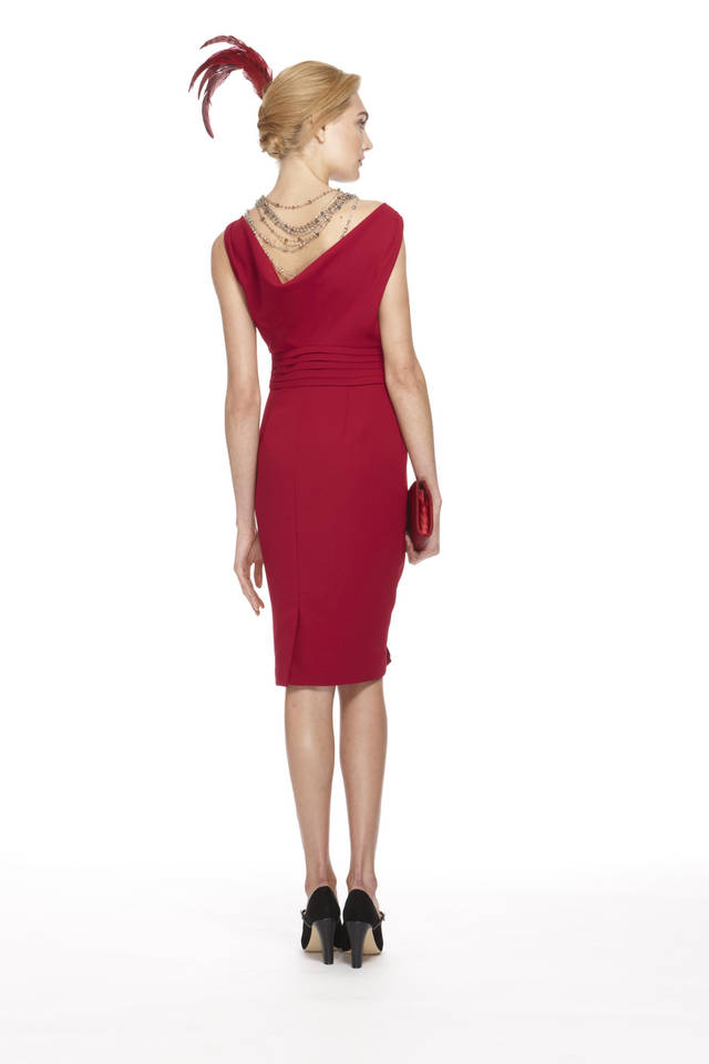 This image released by Banana Republic shows Crimson Cowl-Back Dress, styled with crystal and topaz layered bead necklaces and a red feather from a limited-edition collection designed by Banana Republic. Led by Creative Director and EVP, Simon Kneen, and styled and curated by �Anna Karenina� costume designer Jacqueline Durran, the collection is currently available in Banana Republic stores. (AP Photo/Banana Republic)