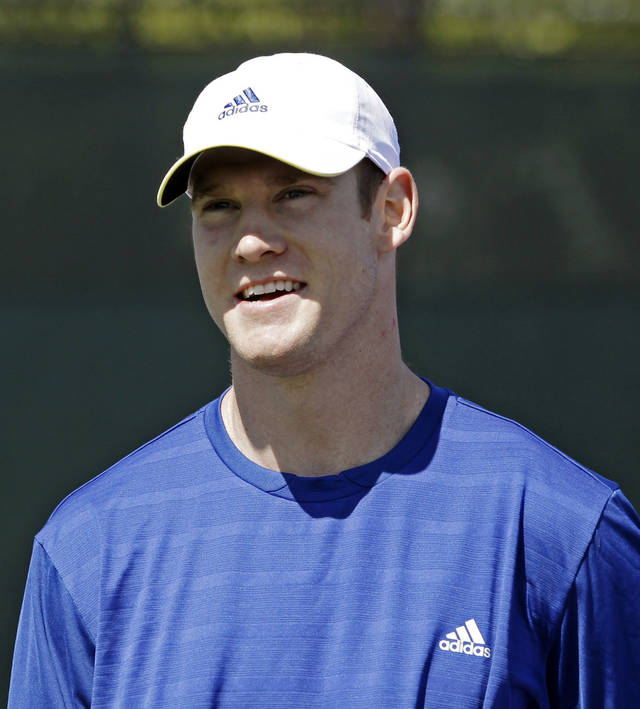 Miami Dolphins quarterback Ryan Tannehill participates in a celebrity tennis event at the Sony Open tennis tournament in Key Biscayne, Fla., Thursday, March 28, 2013. (AP Photo/Alan Diaz)